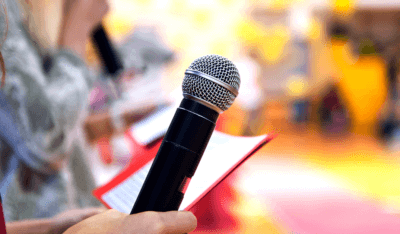 girl holding microphone preparing to give a presentation